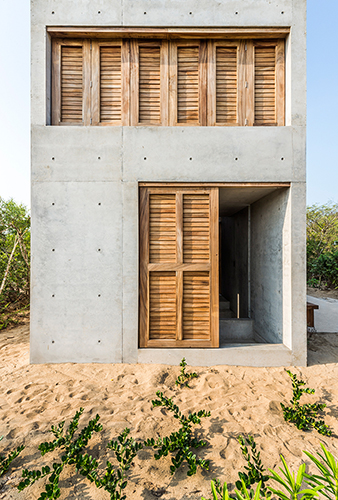 Camila cossio architecture for Half concrete half wood house design